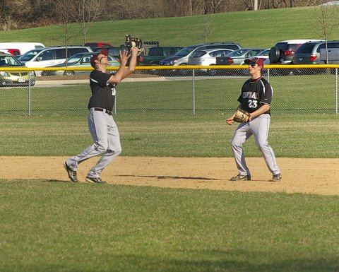 Central's Johnny Wilson catches the popup, with Tim Clark backing up the play. Dave Thoss photo