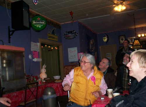 Linda Valentine and supporters watch early results come in.