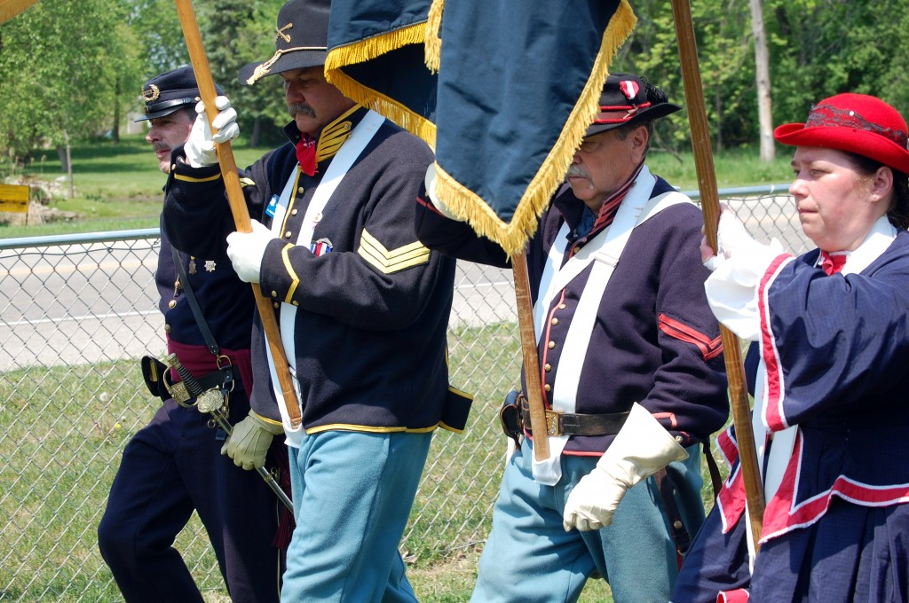 Members of the Sons of Union Veterans of the Civil War and Auxiliary color guard retire the colors.