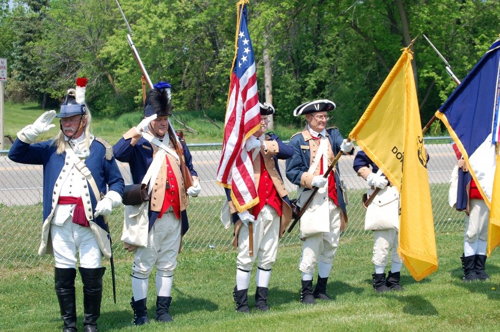 The Wisconsin Society Sons of the American Revolution color guard present the flag during the Pledge of Allegiance.