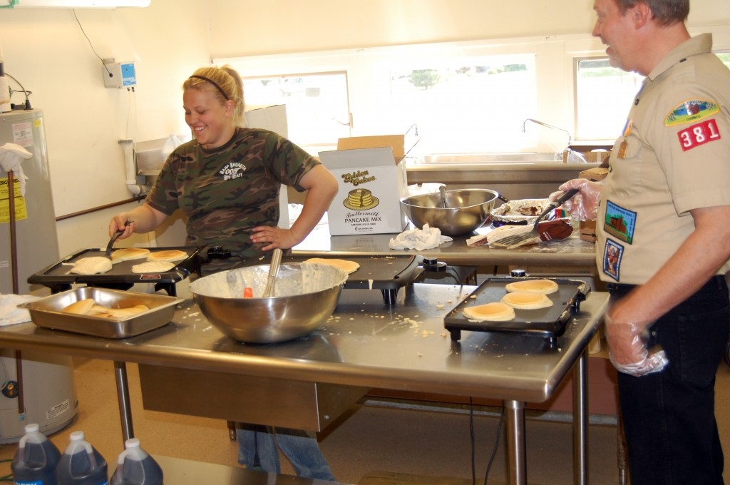 Ashley Rupp and Ray Arbet were taking on the key task of making pancakes.