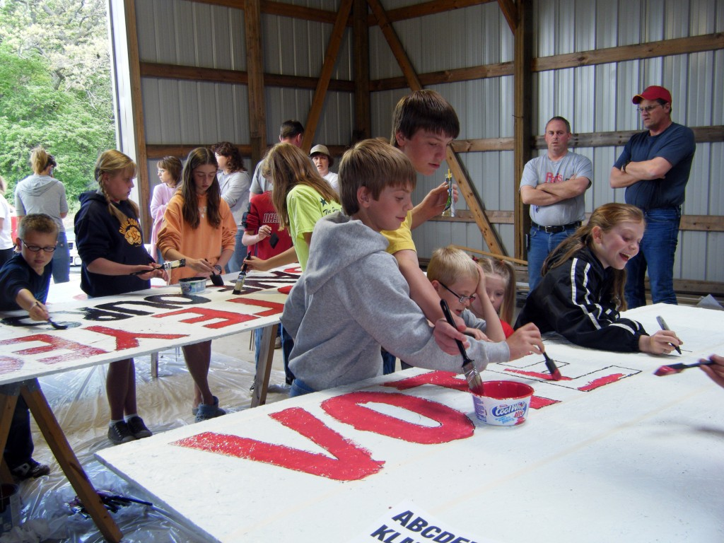 """Paris School students work on large vote """"yes"""" signs Saturday at the LaBell home."""