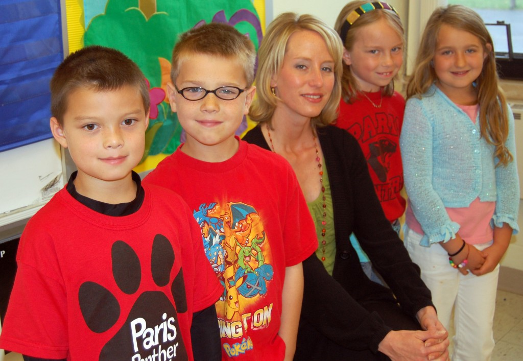 Paris School second grades Mason Yee, (left) Reid LaBell, MacKenzie Fricke (second from left) and Chloey Menarek helped their teacher, Jenny Weis (center) with her master's degree presentation recently in front of an audience of 24 teachers.