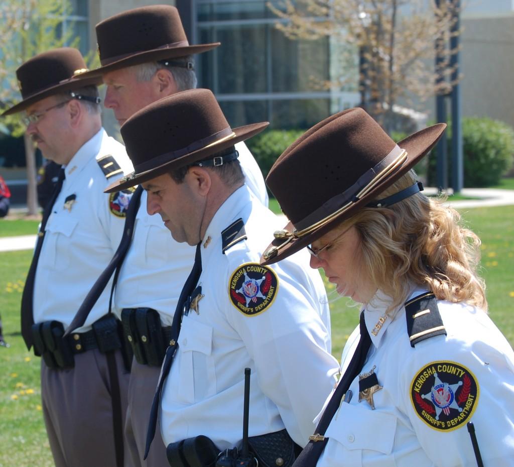 Kenosha Sheriff's Department supervisors listen as a prayer is read.