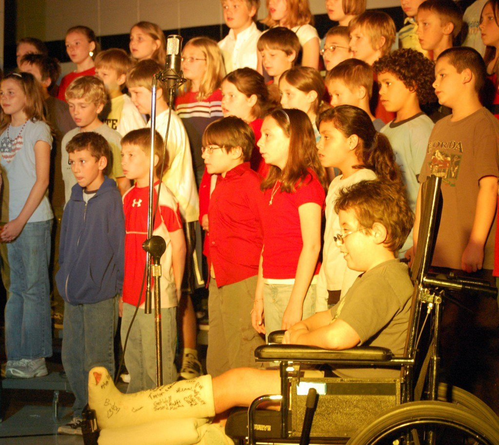 """Fourth graders sang """"Our Heroes Will Live On."""""""