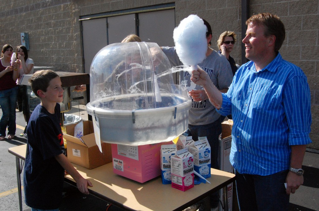 Ben Wepking (right) puts the finishing touches on Daniel Ehr's cotton candy.