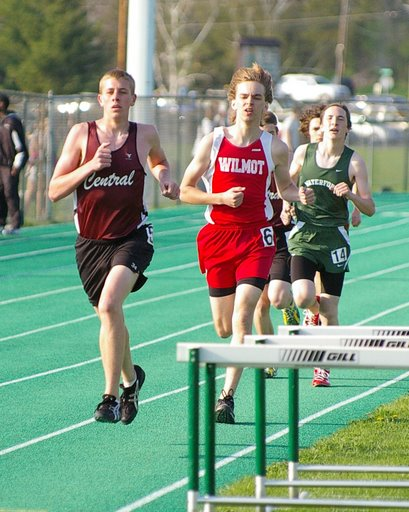 Central's Erik Carlson leads a Wilmot runner in the 3200.