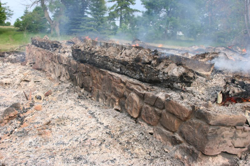 After the burning, the stone foundation was about all that was left. Photo by VALENTINE