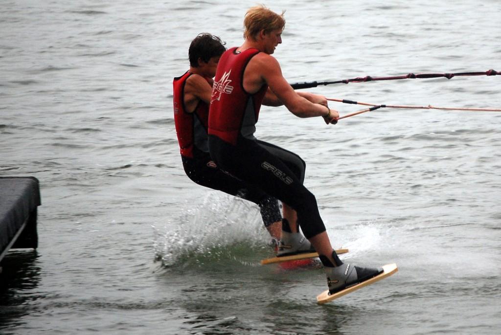 Brenton Kreiger and Brandon Kirchens step off the dock on shoe skis.