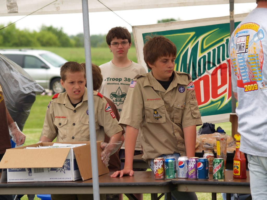 Hunter Longquist and Jeff Schroeder of Boy Scout Troop 381 sell hot dogs and snacks donated by Bumper to Bumper owners to raise funds for their camping trips