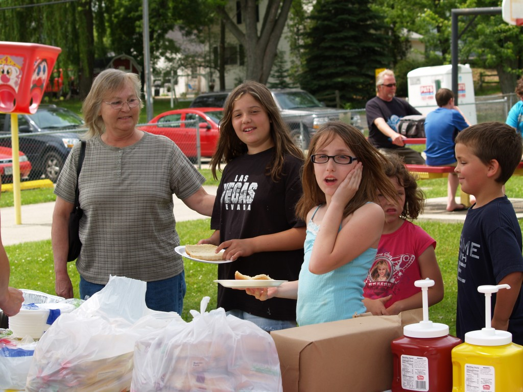Sharon Jacobson waits in line with granddaughter Kiana Vazquez 11, and friend Emma LaForge, 11