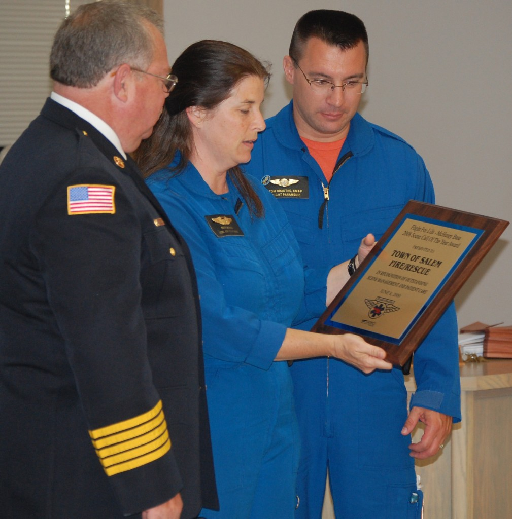 Salem Fire/Rescue Chief Mike Slover (left) receives the award from Flight for Life representatives Patty Mitchell and Tom Bradtke.