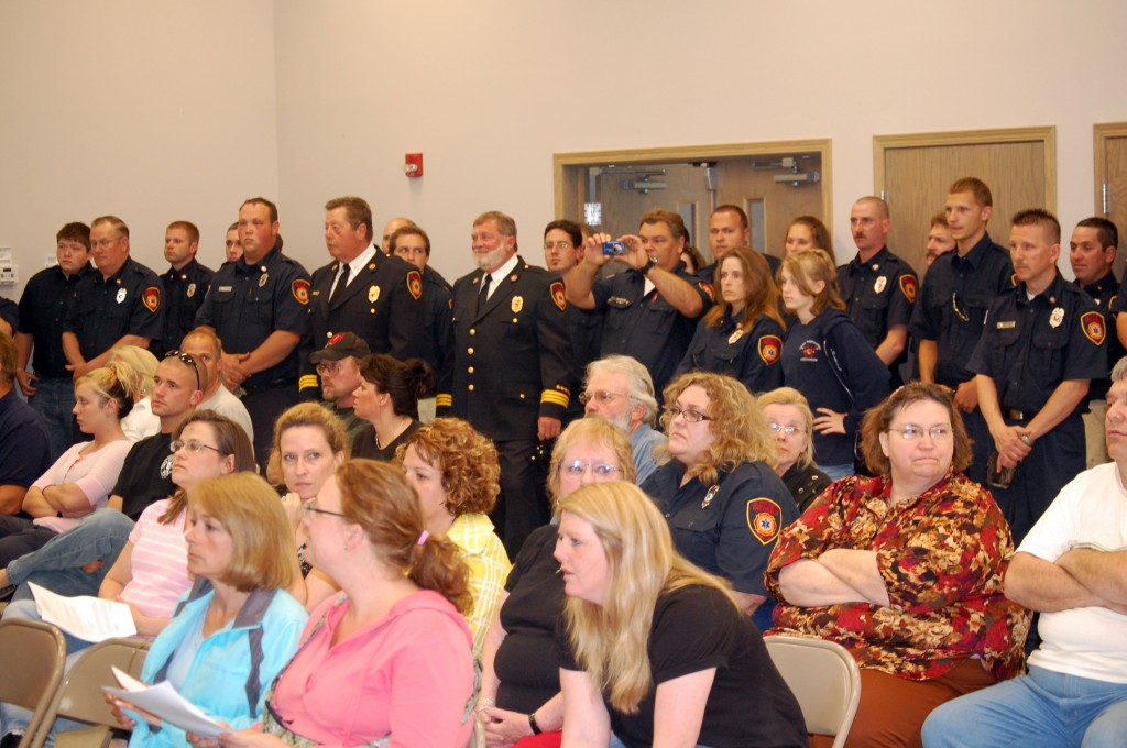 Firefighters line the walls of the Salem Town Hall meeting room before Monday's Flight for Life award ceremony.