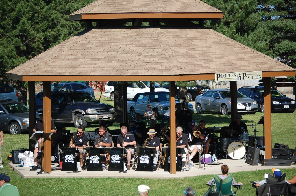 The Pat Crawford Big Band plays under the shelter of the Peoples Pavillion in Schmalfeldt Park.