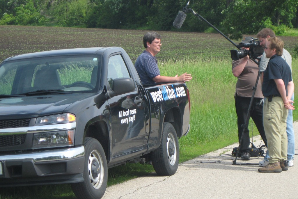 westofthei.com's Darren Hillock is interviewed along the side of a lonely west of the I road by a crew from Wisconsin Public Television. Kurt Greisemer is doing the questioning while Bruce A. Johnson and Jon Duxbury capture video and audio. The WPT team was here producing a piece on the Paris School referendum that will air in January./Photo courtesy of Wisconsin Public Televsion.