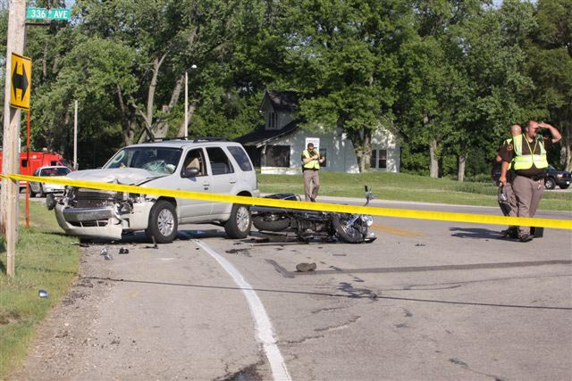 Sheriff's deputies investigate the scene of a motorcycle, SUV crash Sunday afternoon.