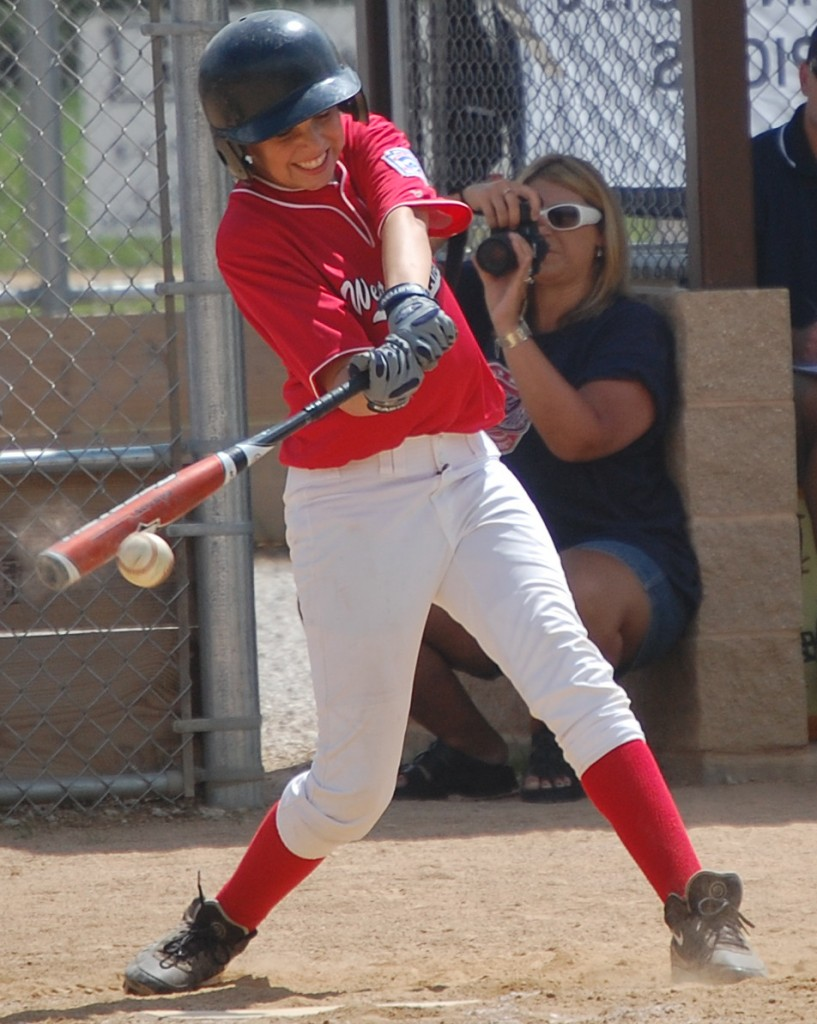 A West Madison batter gets behind this hit. West Madison beat Franklin National in a close game 7 to 6.