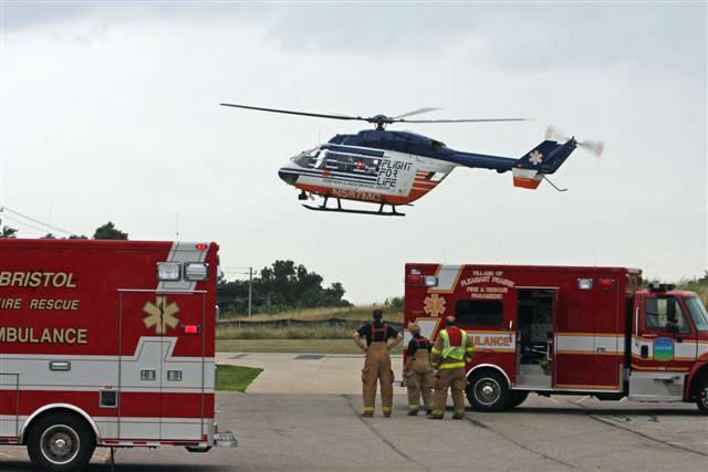 The Flight for Life helicopter leaves the landing pad at the County Center, near the scene of an two-car crash this afternoon./Photo by Earlene Frederick