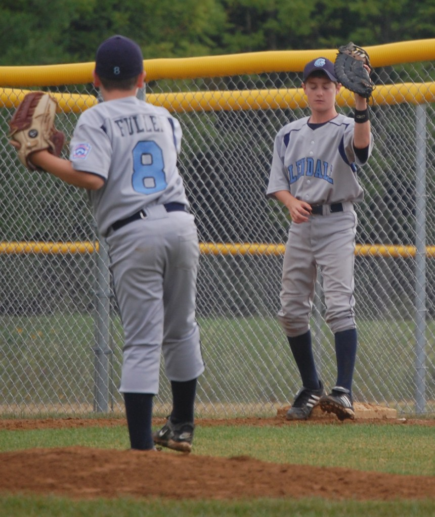 Glendale's pitcher and first baseman complete an out.
