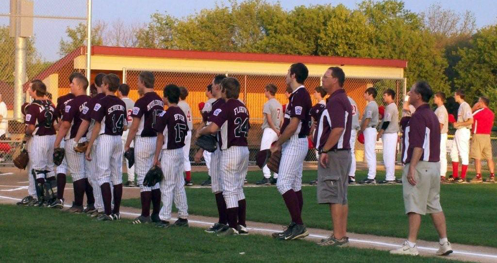 Lakeland Seniors coaches and players line up for the National Anthem and introductions before their first game of the state tournament Wednesday night in Verona.