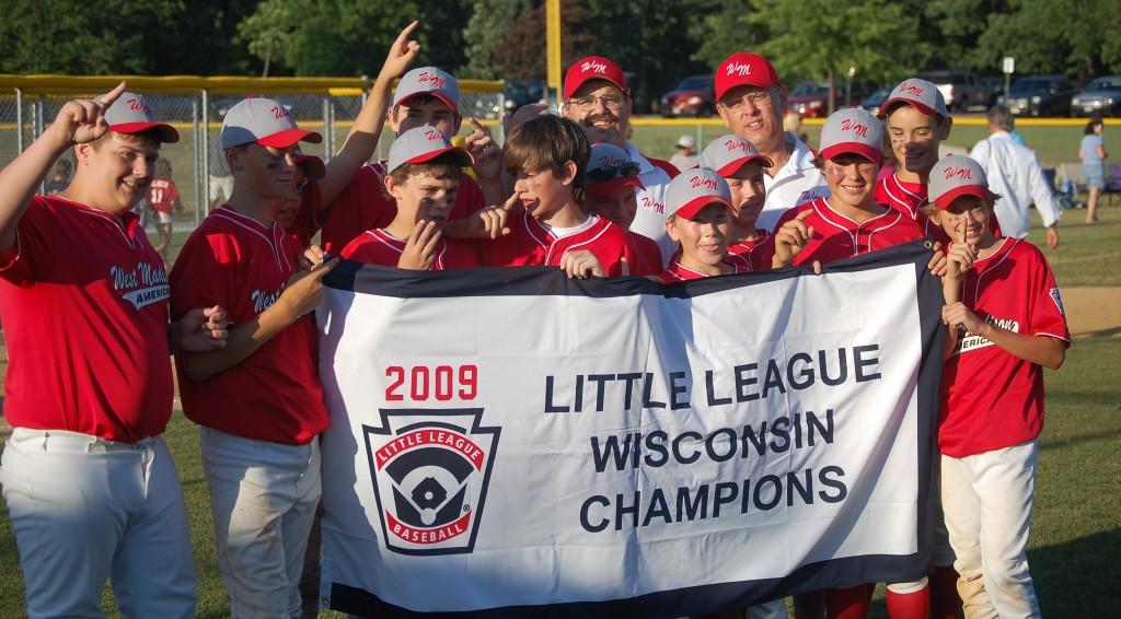 2009 Little League Majors Champs West Madison accept their flag and celebrate.