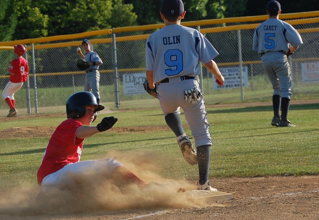 A West Madison runner slides safely into third.
