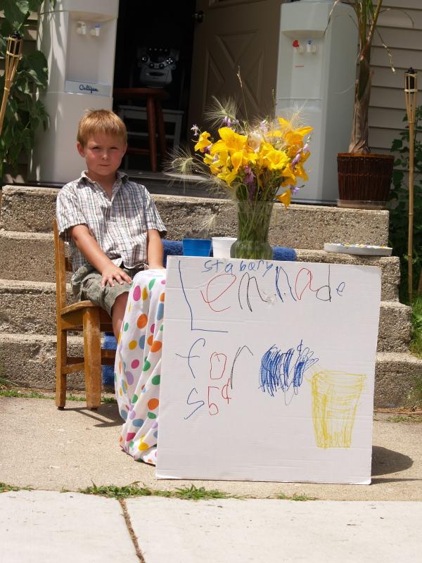 Young Entrepreneur Kaiden Moore, age 6, sells Lemonade during parade
