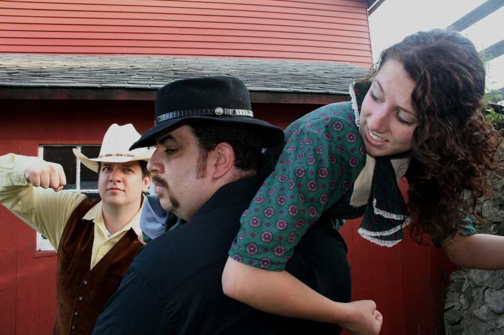 """Nelson (as Ned Harris the hero), Tim West (as Blackburn Redburn or the real Deadwood Dick), Alyssa Williamson (as the damsel in distress Lily) act out a scene from """"Deadwood Dick, or the Game of Gold."""""""