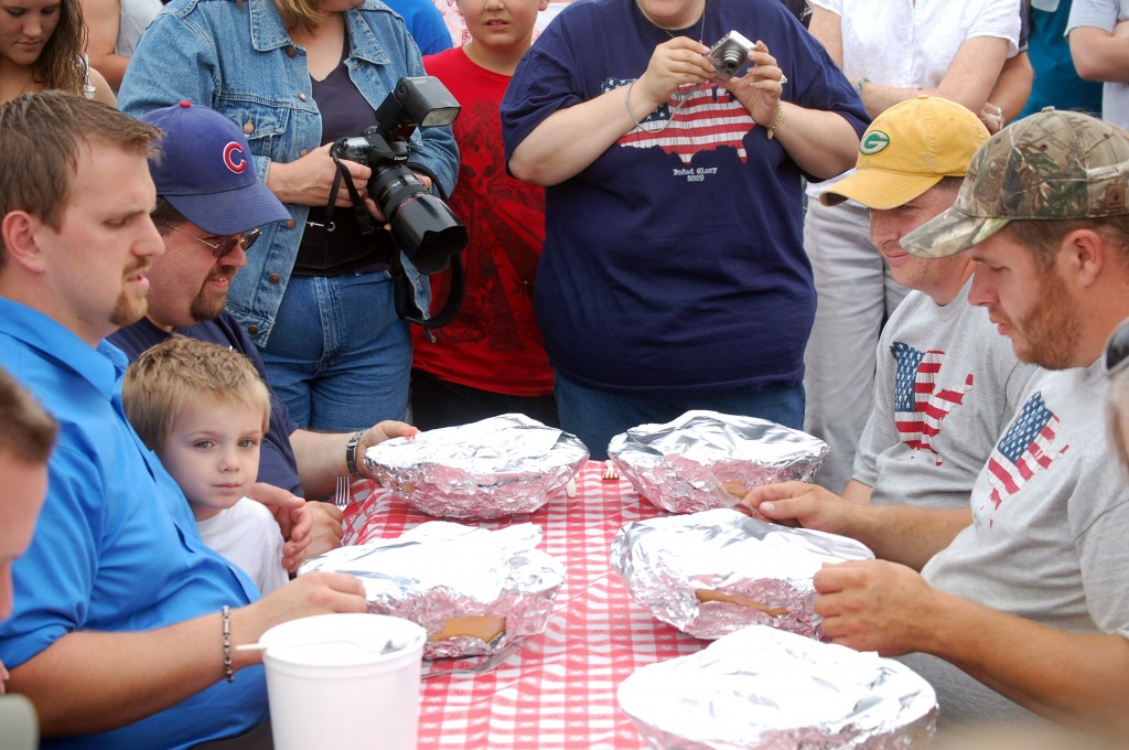With the kids done, the adults move dup to the pasta eating table. Here, some of the contestants contemplate the much larger size of the adult portion -- one full pound of spaghetti.