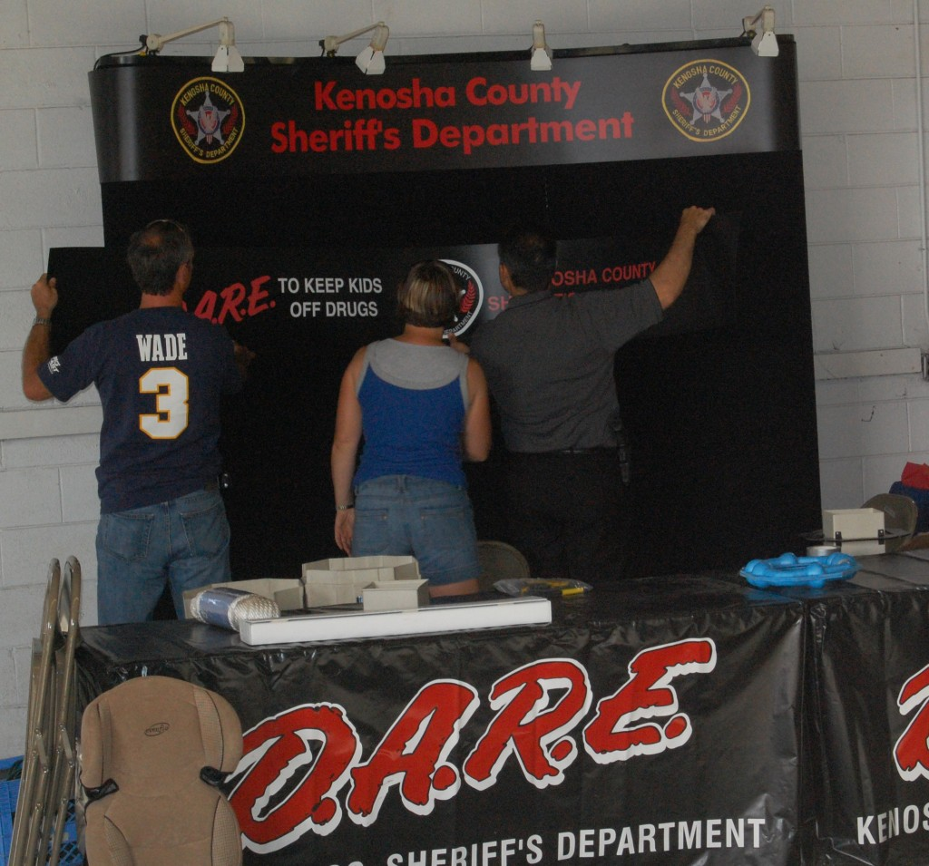 The Kenosha County Sheriff's Department D.A.R.E. booth was one of many being constructed in the commercial building.