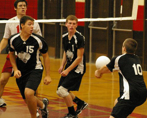 Andrew Thoss, 10, passes to Dayton Erikson, 1 for a set, as Feivor gets in position. /David Thoss photo