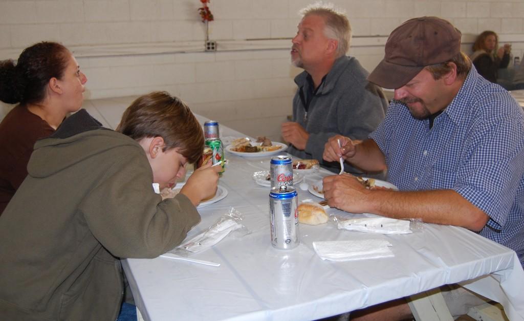 Enjoying the spread at the Kenosha County Fair Buyers Appreciation Dinner are (clockwise from left) Ray Vejvoda, Cari Vejvoda, Ed Vejvoda and John Neuroth.