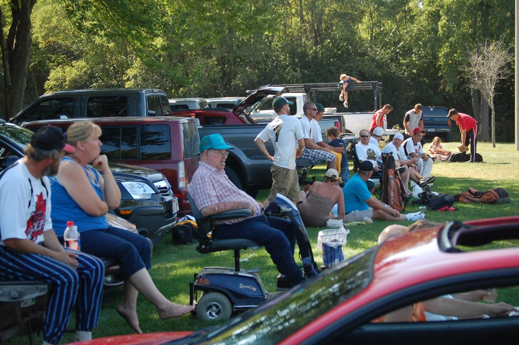 """The event may have been called """"Fall"""" Festivus, but the weather seemed more like June. The most comfortable spot to watch the softball action was not the bleachers, but under the row trees south of the diamond."""