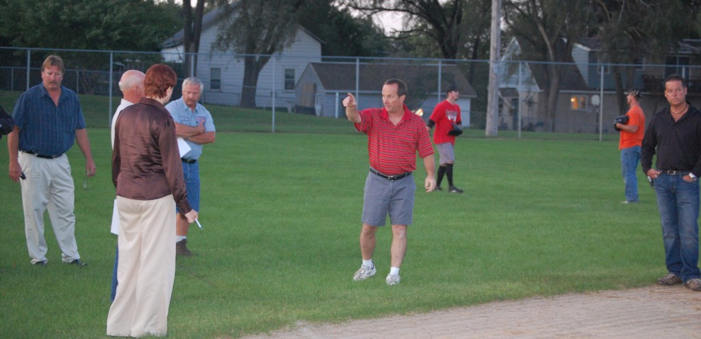 Wheatland Recreation Board Chairman Jeff Niederer explains to other board members, Town Board members and members of the public the situation with New Munster Park softball field. The group took a look at the field during a Recreation Board meeting Monday evening.