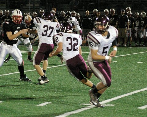 Cetnral's Sean Flahive, 32 takes off with help from Aaron Fincher, 37 blocking./David Thoss photo