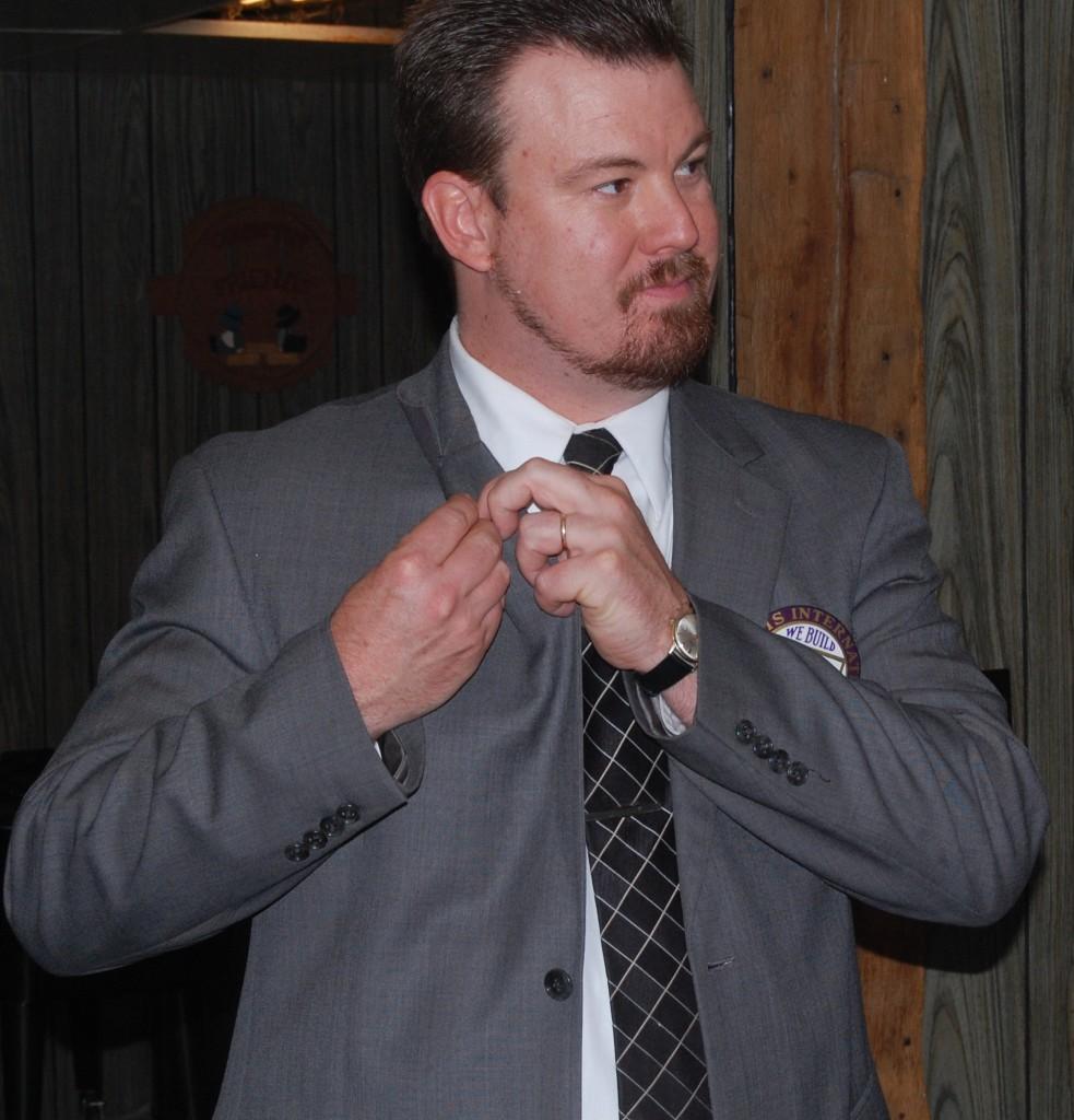 Rick Zawacki puts on his president pin. Zawacki is the new president of the Westosha Kiwanis Club.