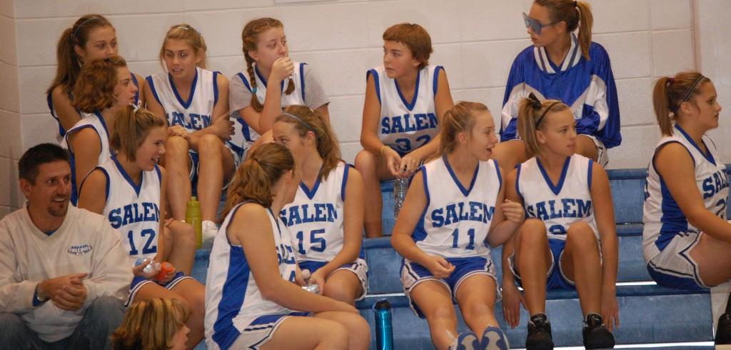 The Salem team watches the Randall-Bristol game and waits for their chance to get on the court.
