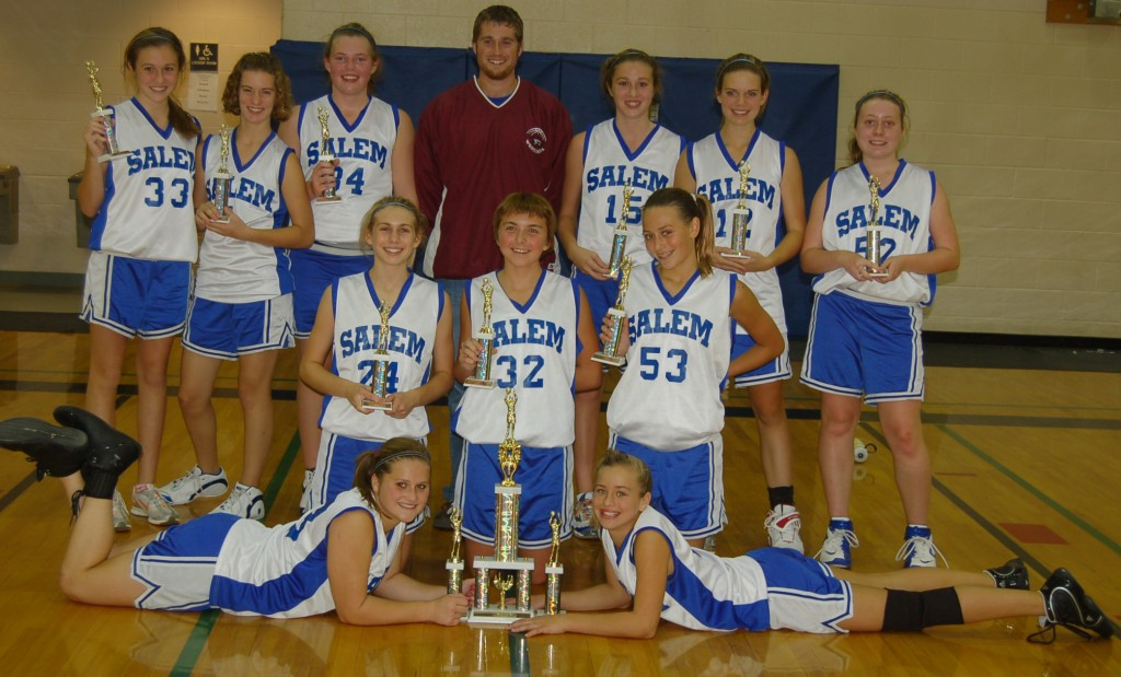The Salem School A-team girls poses with their Comet Invitational first place trophy