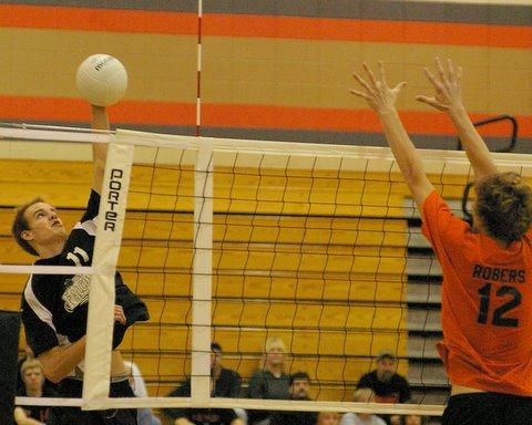Tyler Barnstable hits against Burlington./David Thoss photo