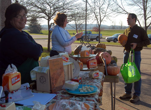 Jill Thompson of Pineview Farms (left) and Katelyn Gollberg of Larryville Farms were at the farmer's market. Pineview Farms was offering cheese and Larryville Farms heirloom squash.