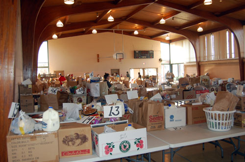 By 9:30 a.m., the Holy Cross Church-Wilmot gym was full of food bound for adopted families this Thanksgiving.