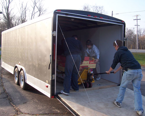 Some of the food donated by the Twin Lakes Chamber Foundation is unloaded. Bill Jones, Ryan Jones, Brandon Jones, Shannon Dimiceli and Matt Jones unloaded 50 turkeys, 100 bags of stuffing, 50 5lb bags of potatoes, 150 cans of gravy, 100 cans of vegetables, 100 cans of cranberries, 50 large cans of yams and 50 pumpkin pies.