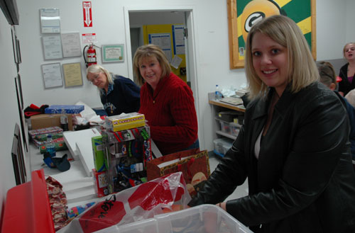Barbara Teitz, Nan Haase and Noelle Racer helped wrap the gifts the shoppers purchased.