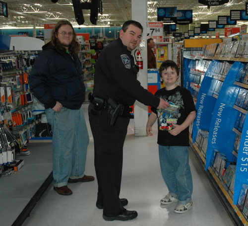 Officer Cooper presented a certificate to surprise shopper Jacob Marousek. /Submitted photo
