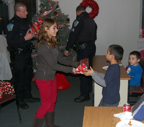 Participants in the Antioch Police Department's Shop With a Cop program recieve a gift for themselves before going off to shop for others. These toys for the children were donated by the Mattel Toy Store in Wilmot.