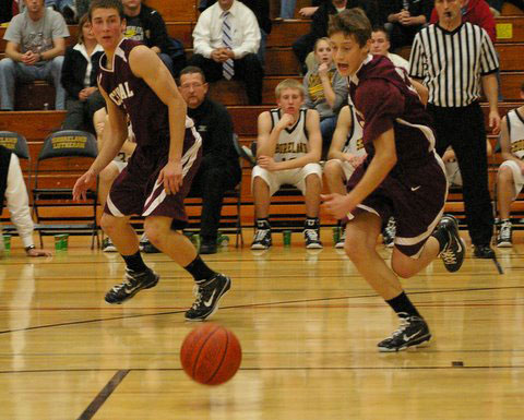 Mike Michelau goes for loose ball as Austin Damaschke gets ready to go up court. /David Thoss photo
