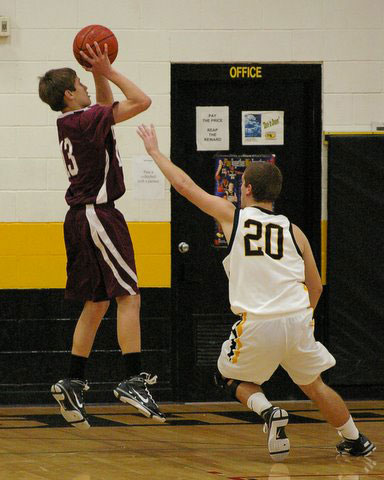 Mike Michelau goes up for 2 of his team leading 8 against Shoreland. /David Thoss photo