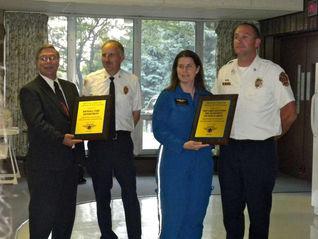 Jim Singer and Patty Mitchell from Flight for Life McHenry present  plaques to Twin Lakes and Randall Fire and Rescue Departments