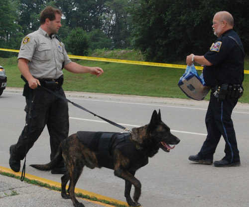 A Racine County Sheriff's Department canine handler gets a bottle of water from Constable Bob Haas. This file photo was taken on June 15, 2010 after a person Haas pulled over, showed a weapon fled and led police on a lengthy manhunt.