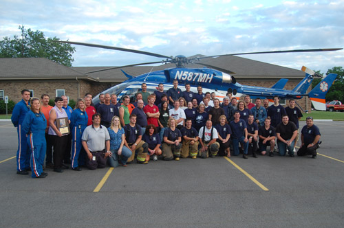 Members of Salem Fire/Rescue and the Flight For Life crew pose in front of the FFL helicopter in the Salem Town Hall parking lot Monday. /Darren Hillock photo